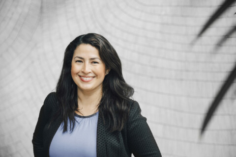 headshot of woman in business attire smiling at camera