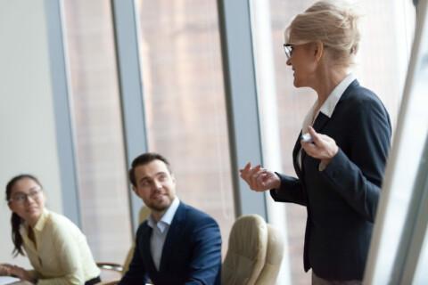 Successful team leader businesswoman boss present new project