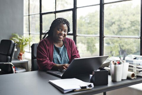 Businesswoman working on laptop at workplace